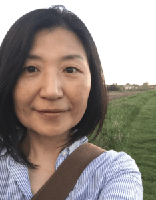 Photo of Sujung Kim in a field