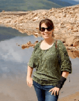 Photo of Jessica Bohemian with a lake and rocky hillside in the background