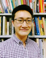 Photo of Jonathan Kwan in front of a bookshelf