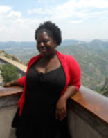 Photo of Makeba Lavan standing in front of a view of hills and valleys