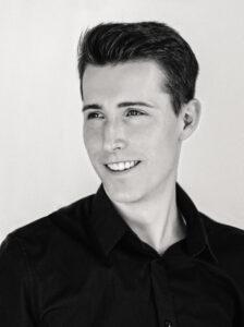 Black and white profile photo of Greg Hartmann